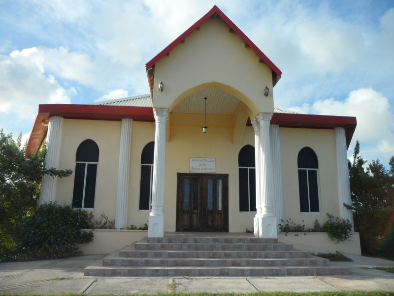 Church of God of Holiness, Queen Elizabeth Highway, Anguilla. Flamboyant tree in the front