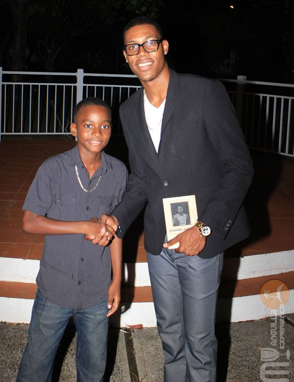 Zharnel Hughes and young athlete