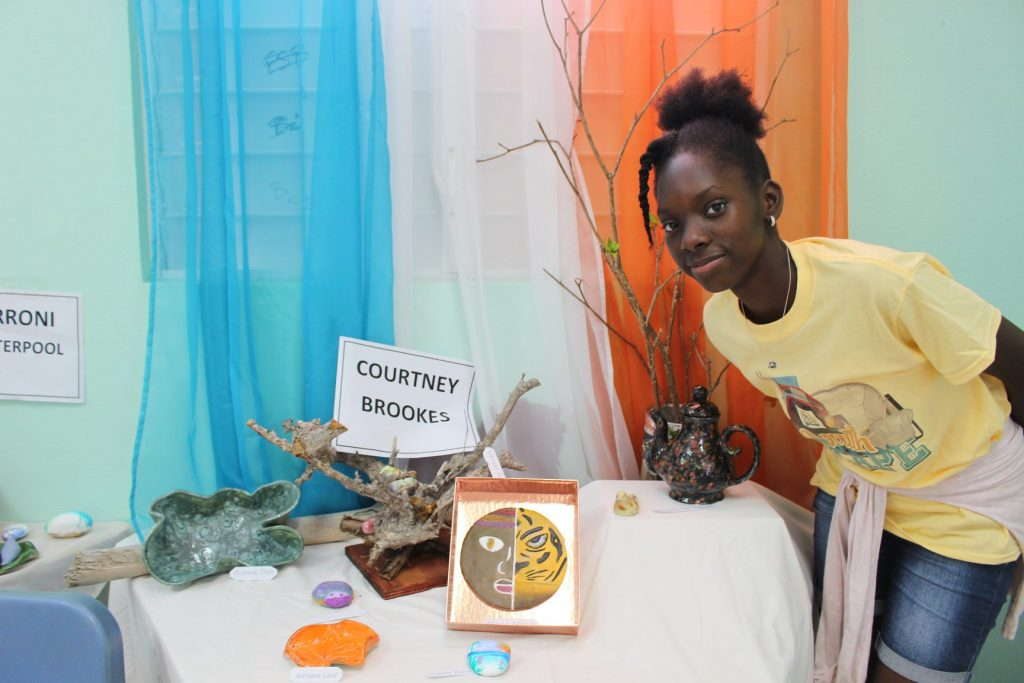 Courtney Brooks proudly displays her work at pottery exhibition